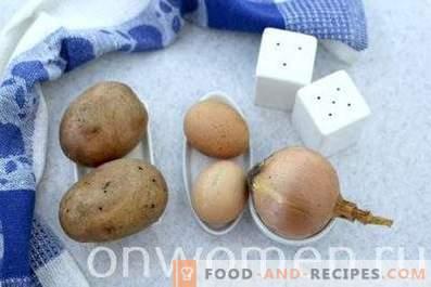 Patatas fritas con cebolla, ajo y huevos